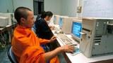 laos-monk-using-computer-mar8-2009.jpg