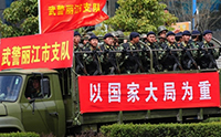 Armed paramilitary police are paraded by the truckload along the streets of Lijiang, south of Shangrila on March 24, 2008 in southwest China's Yunnan province. AFP