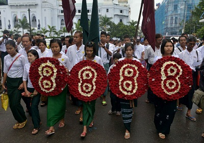 Students carrying wreaths marked with the number eight march in Yangon on Aug. 8, 2013 to mark the anniversary of the 1988 crackdown. Photo credit: AFP.