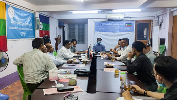 Abdul Rasheed (4th from L) and other members of the Democracy and Human Rights Party meet in the party's office in Yangon, Aug. 13, 2020.