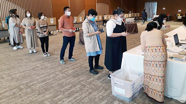 Myanmar nationals line up inside the Myanmar Embassy in Tokyo, Japan, on Oct. 6, 2020, to cast absentee ballots for the upcoming elections in their home country.