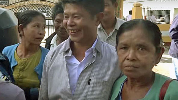 A Kyaung Taung villager (C) smiles after he is released by a court in Mrauk-U township, western Myanmar's Rakhine state, Jan. 8, 2019.