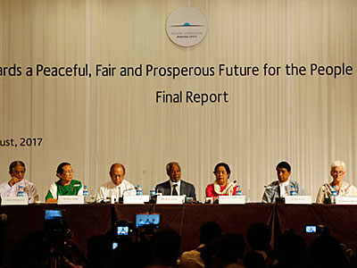 The members of the Advisory Commission on Rakhine State present their final report at a press conference in Yangon, Aug. 24, 2017.