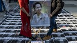 Activists hold a portrait of Myanmar's de facto leader Aung San Suu Kyi while standing on portraits of the country's military general Min Aung Hlaing during a protest outside the United Nations University building in Tokyo on Feb. 1, 2021,