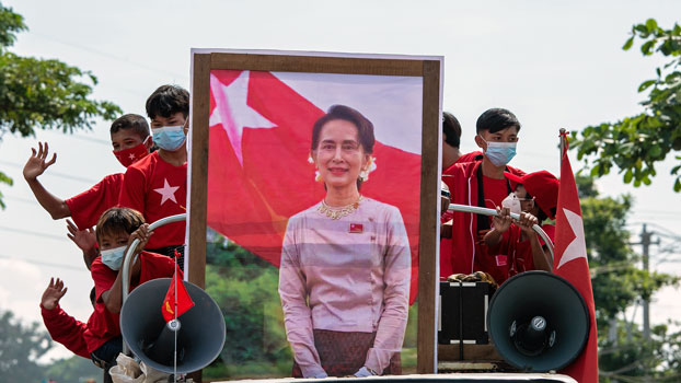 National League for Democracy party supporters take part in an election campaign event with a portrait of Myanmar State Counselor Aung San Suu Kyi, in Yangon, Oct. 25, 2020.