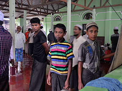 Rohingya Muslim men and boys arrive for Friday prayers at a camp in Sittwe, western Myanmar's Rakhine state, June 10, 2016. Credit: AFP