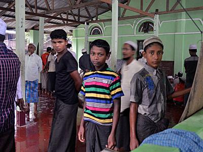 Rohingya Muslim men and boys arrive for Friday prayers at a camp in Sittwe, western Myanmar's Rakhine state, June 10, 2016.