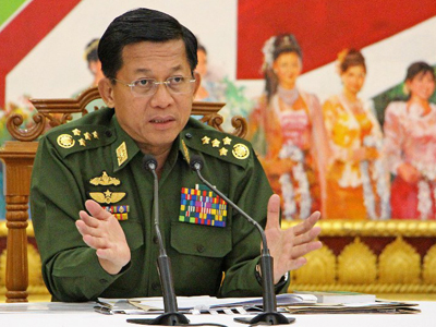 Myanmar's army chief General Min Aung Hlaing addresses reporters during an interview with local and international media in Naypyidaw, Sept. 21, 2015.