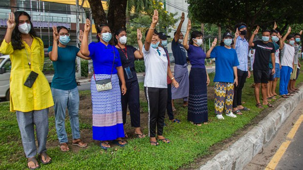 Myanmar Protesters Don Blue Shirts to Challenge Junta Amid Widespread Arrests of Youth