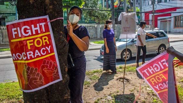 myanmar-anti-coup-protesters-posters-yangon-apr21-2021.jpg