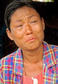 A survivor of the cyclone Nargis cries in Kyaiklat, in the Ayeyarwady Division of south-west Burma on 12 May, 2008. The flow of international aid into Burma, which says 62,000 people are dead or missing, has increased in the past two days. Photo: AFP/ Khin Maung Win
