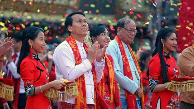 Yangon region Chief Minister Phyo Min Thein (2nd from L) claps during a celebration marking the Lunar New Year along with his wife (C) at Chinatown in Yangon, Jan. 25, 2020.