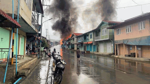 Homes in Thantlang in western Myanmar's Chin state burn after being hit by artillery fire by Myanmar junta forces amid clashes with local joint militia groups, Sept. 18, 2021. Credit: Citizen journalist