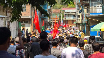 Protesters demonstrate in Hpakant in Myanmar's northern Kachin state in support of Mindat, a town in Chin state where a civilian defense force has clashed with the military, May 16, 2021.
