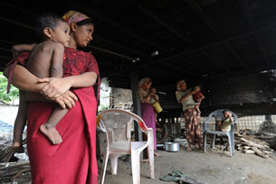 Muslim women hold their children at their house in Sittwe, June 6, 2012.