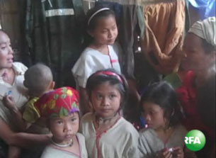 A group of Karen children, who say they were used as porters by soldiers in Burma, gather in a village for refugees in northern Thailand, Aug. 23, 2009.