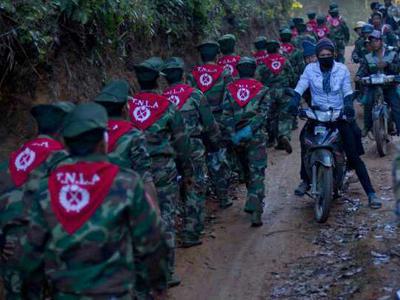 Rebels pass through a mountainous region of Myanmar's Shan state, March 11, 2015. Credit: Kokang volunteer