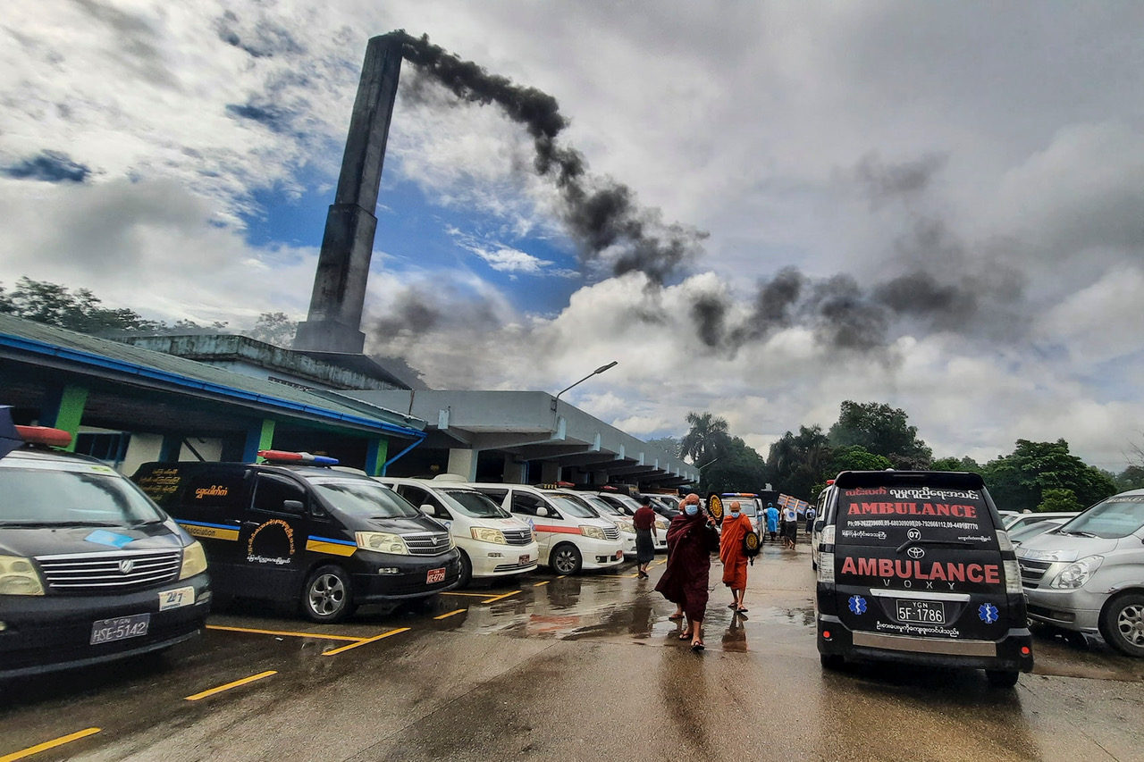 004Monks seen after funeral sermon at Yayway crematorium in Yangon as smoke rising from chimney on Jul 12_Credit Bo Sein.jpeg