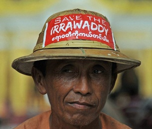 A man wearing a 'Save the Irrawaddy' sticker takes part in a protest in Rangoon on Sept. 27, 2011.