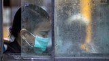 myanmar-woman-surgical-mask-bus-yangon-july26-2017.jpg