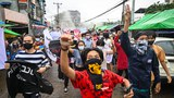 Protesters take part in a demonstration against the military coup and to mark the anniversary of 1962 student protests against the country's first junta in Yangon, July 7, 2021.