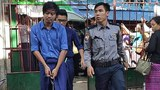 Zayar Lwin, a leader of the Peacock Generation satirical performance troupe, is led to the Maubin Township Court to be sentenced on charges of 'defaming' Myanmar's military, Dec. 15, 2020.