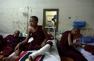 Monks injured in the crackdown on the copper mine protests rest at a hospital in Mandalay on Dec. 3, 2012.