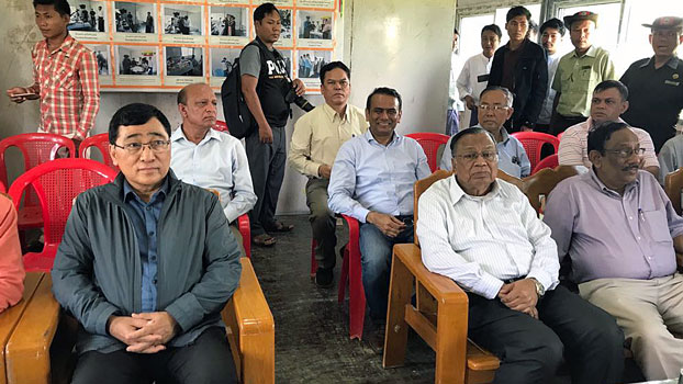 Bangladesh's Foreign Minister Abdul Hassan Mahmood Ali (front row, 2nd from R) sits in an office during a visit to western Myanmar's Rakhine state, Aug. 11, 2018.