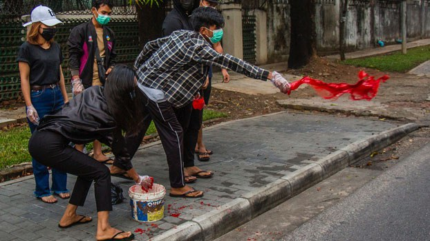 myanmar-protesters-throw-red-paint-yangon-apr6-2021.jpg