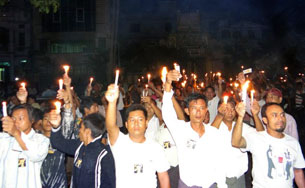 Residents of Mandalay hold a candlelight protest against electricity cuts, May 21, 2012.