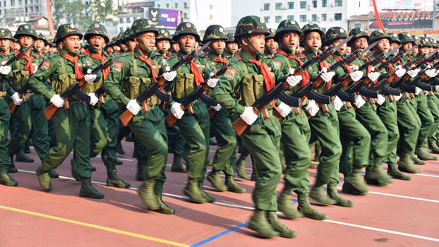 United Wa State Army soldiers march during a military parade commemorating 30 years of a bilateral cease-fire signed with the Myanmar military, in the town of Pangsang in Myanmar's Wa self-administered region, April 17, 2019.