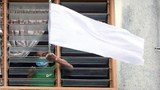 A white flag is displayed at a home in Yangon, in an undated photo.