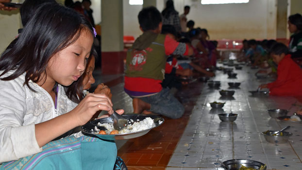 Children displaced by armed conflict in Myanmar's northern Shan state eat a meal at a shelter in Kutkai township, Aug. 22, 2019.
