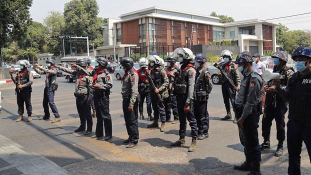 myanmar-police-patrol-street-us-embassy-yangon-feb23-2021.jpg
