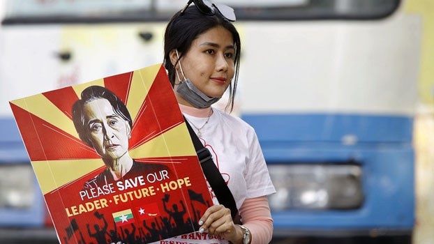 myanmar-protester-indonesia-embassy-yangon-feb23-2021.jpg
