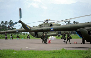 Army helicopters sit on the tarmac at the airport in Sittwe, June 12, 2012.