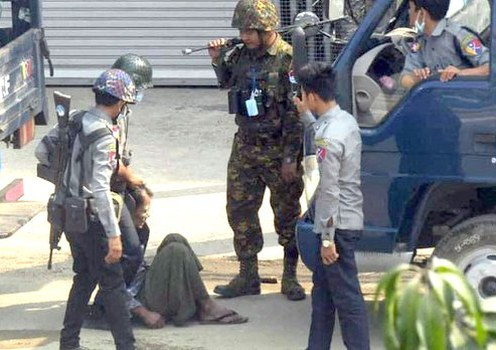 Security forces beat a detainee in Yangon's North Okkalapa township, March 19, 2021.