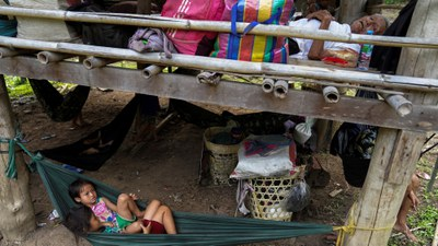 Villagers rest in Mae Hong Son province, Thailand, after fleeing fighting between ethnic minority Karen insurgents and the military in Myanmar, April 29, 2021.
