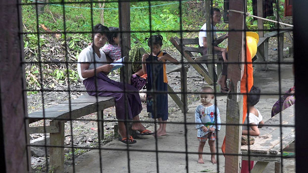 Villagers who fled a conflict zone in Paletwa township, eastern Myanmar's Chin state, take refuge in a temporary camp for displaced persons at the Ngazinyaing Chaung Monastery compound in Sittwe, capital of neighboring Rakhine state, Aug. 10, 2020.