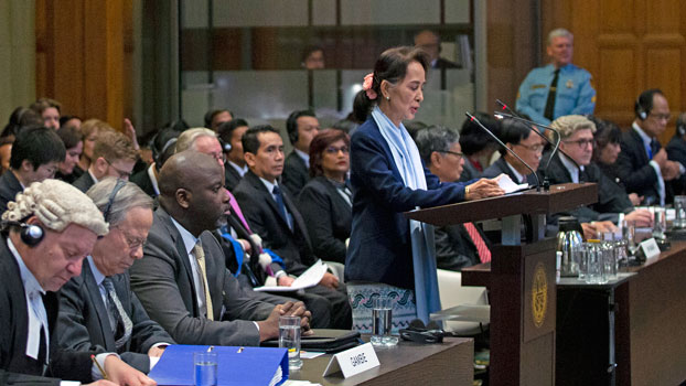 Myanmar State Counselor Aung San Suu Kyi (standing) addresses the judges of the International Court of Justice during a three-day hearing on the Rohingya genocide case against Myanmar at The  Hague, the Netherlands, Dec. 11, 2019.
