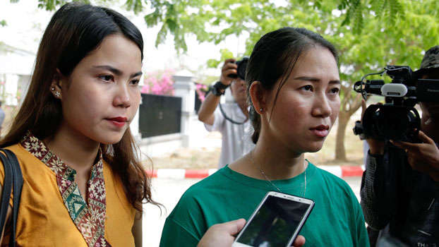 Chit Su Win (L), wife of Kyaw Soe Oo, and Pan Ei Mon (R), wife of Wa Lone, talk to the media after attending a hearing for their husbands at Myanmar's Supreme Court in Naypyidaw, April 23, 2019.