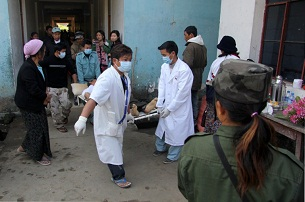 Medical staff carry an injured man on a stretcher at the Laiza hospital, Jan. 14, 2013.