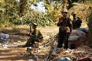 KIA 3rd Brigade soldiers stand guard as they secure an area on Hka Ya mountain in Kachin state, Jan. 20, 2013.