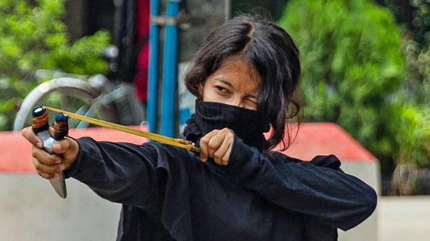 myanmar-protester-slingshot-thaketa-twp-yangon-mar30-2021.jpg