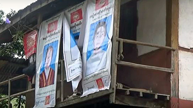 Posters hanging in a village show ethnic Karenni candidates who will run in Myanmar's general election in November, in eastern Myanmar's Kayah state, July 28, 2020.