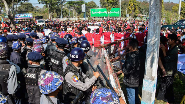 Myanmar police block protesters as they gather near a statue of General Aung San during a demonstration in Loikaw, capital of eastern Myanmar's Kayah state, Feb. 12, 2019.