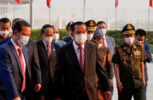Cambodian Prime Minister Hun Sen arrives to receive a shipment of 600,000 doses of the coronavirus disease (COVID-19) vaccines donated by China from ambassador Wang Wentian, at the Phnom Penh International Airport, in Phnom Penh, Cambodia February 7, 2021. Reuters
