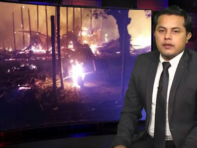 In this screen grab from a YouTube video, Ajmeer Omar presents the news during Wednesday's Rohingya Vision TV broadcast, Jan. 31, 2018.