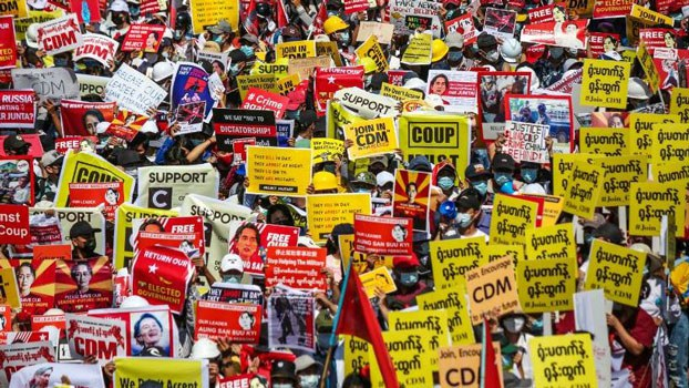 myanmar-street-protesters-with-signs-feb17-2021.JPG