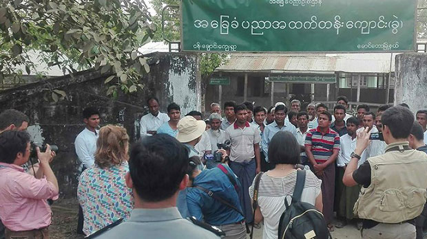 A group of foreign journalists interviewing Muslim Rohingya residents during a government controlled trip in Maungdaw, near the Myanmar-Bangladesh border, in photo released by Myanmar News Agency on April 3, 2018.